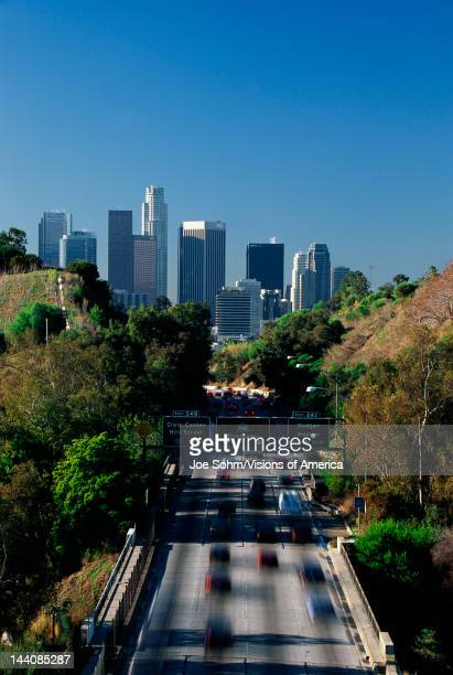 This is morning rush hour traffic on the Pasadena Freeway, It is near Dodger Stadium with the skyline in the background.