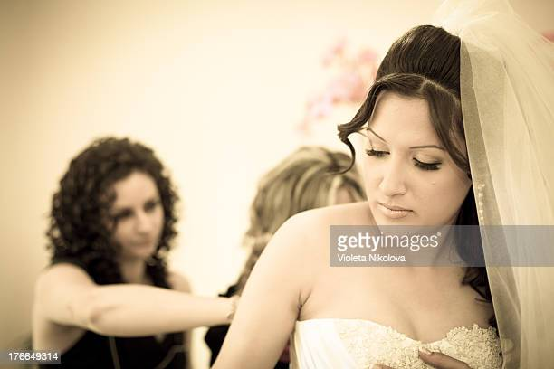 This is my firs bride! She was so beautiful, so young. This is the moment where her bridesmades are helping her to put on her dress.