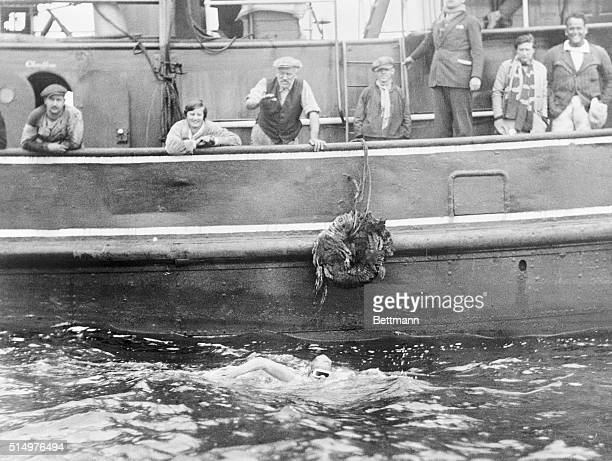 This is one of the first photos to arrive in America from Europe via Quebec and airplane to New York showing Gertrude Ederle in her successful...