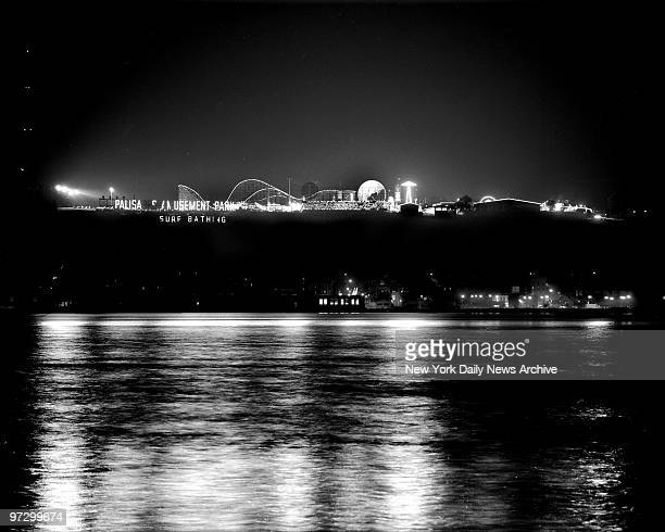 This is Palisades Amusement Park in NJ at night as seen from across the Hudson a familiar sight to motorists along Manhattan's West Side Highway