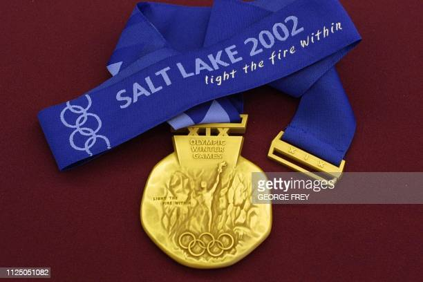 This is photo taken 15 October 2001 shows the front of the Gold Medal for Salt Lake City 2002 Winter Olympic medals displayed at an unveiling...