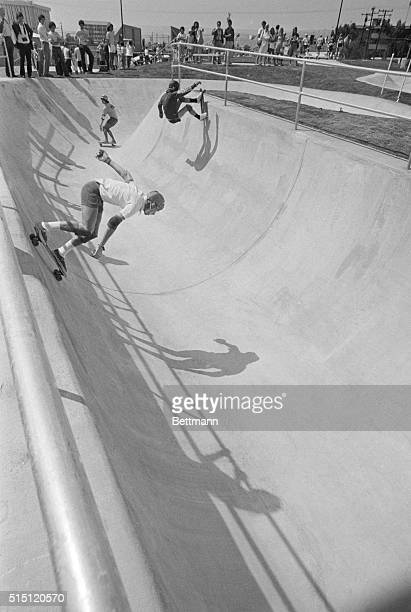"""This is some of the action in the """"bowl,"""" an area shaped like a bowl with high banks, at the new million dollar skateboard park in Torrance during..."""