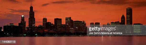 This is the complete Chicago skyline with the Chicago Harbor in the foreground It is the view from the Adler Planetarium at sunset during summer The...