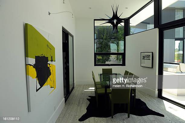 This is the dining room This is the home of Cathleen Van Buskirk and her snazzy home at the Erie Air Park Her sleek modern house is right by the...