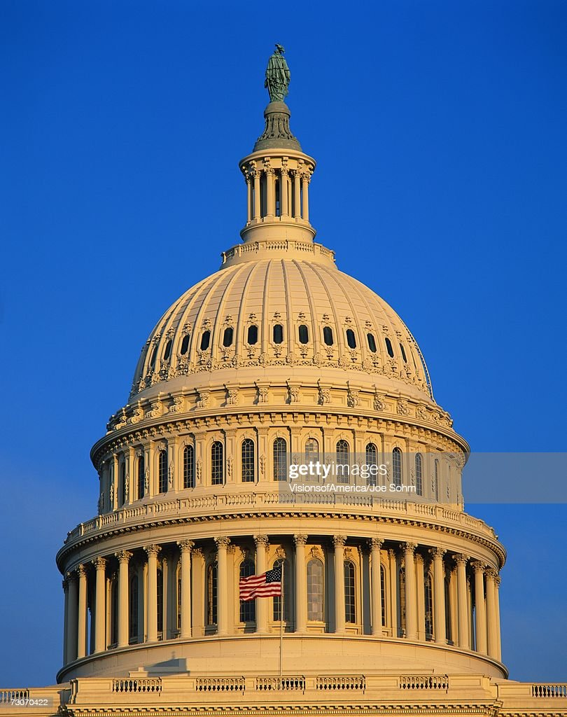 this is the dome of the us capitol against a blue sky there is an