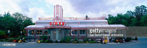 This is the Eveready Diner It is a 50's style diner whose building looks similar to an old train car The roof is made from a silver chrome with...