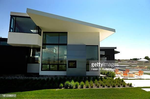 This is the exterior of the house with her plane on the right outside the hangar This is the home of Cathleen Van Buskirk and her snazzy home at the...