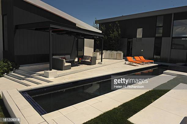 This is the exterior of the house with the lap pool and seating area with barbque This is the home of Cathleen Van Buskirk and her snazzy home at the...