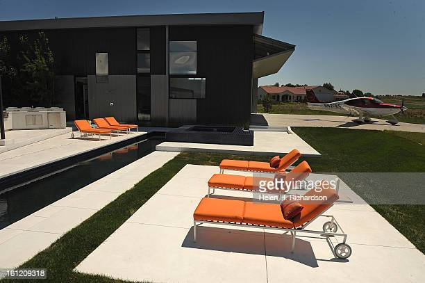 This is the exterior of the house with the plane at right sitting in front of the hangar This is the home of Cathleen Van Buskirk and her snazzy home...
