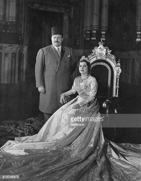 This is the first posed picture of King Farouk of Egypt and his new bride 17yearold Queen Narriman in the throne room at Abdin Palace in Cairo The...