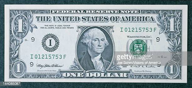 This is the front of a one dollar bill showing the portrait of George Washington in the center