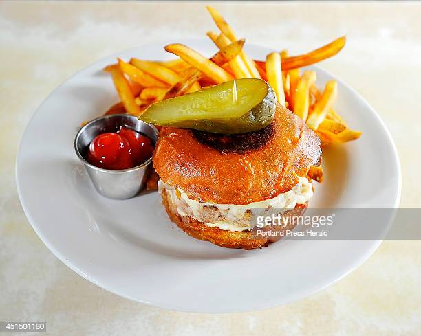 This is the grassfed burger with griddled onions sharp cheddar cheese on a brioche bun with crunchy fries a pickle and ketchup from the Palace Diner...