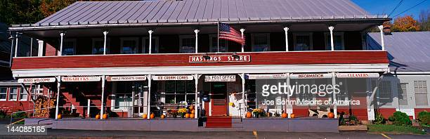 This is the Hastings General Store and post office It shows a large red building where they sell general goods much the same way they did a century...