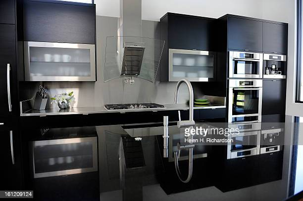 This is the kitchen This is the home of Cathleen Van Buskirk and her snazzy home at the Erie Air Park Her sleek modern house is right by the runway...