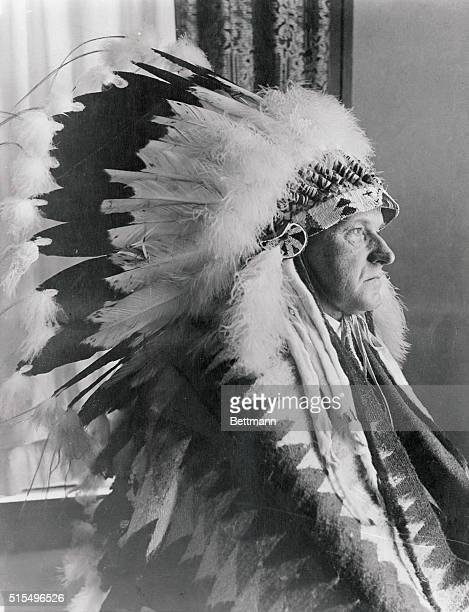 This is the latest portrait to be made of the President at the State Game Lodge He is shown wearing the feathered head dress given by the Sioux...