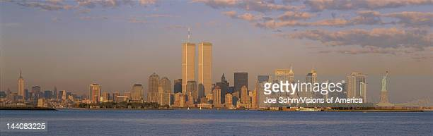 This is the Manhattan skyline from New Jersey It includes the Empire State Building World Trade Towers Statue of Liberty and Brooklyn Bridge