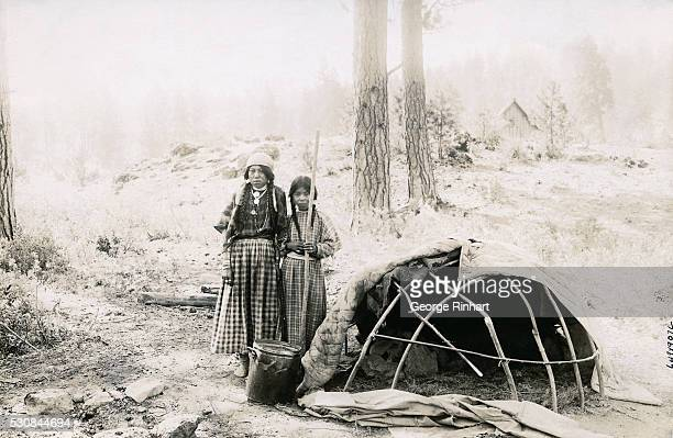 This is the manner in which the Siwash Indians believe in curing their small pox and pneumonia cases They build a sweat hut on the bank of a creek in...