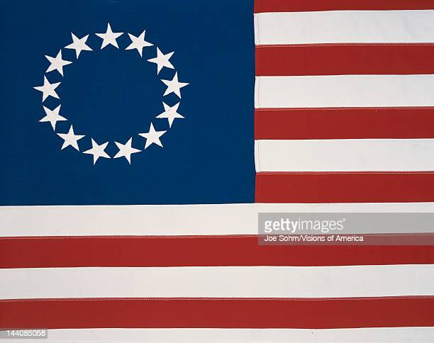 This is the original colonial flag with 13 stars representing the 13 original states at the time of the American Revolutionary War The 13 stars are...