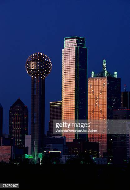 This is the skyline at dusk. It shows the Reunion Tower which is 50 stories high.