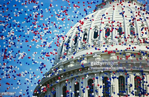 'This is the U.S. Capitol during the Bicentennial of the Constitution Celebration. There are red, white and blue balloons falling around the Capitol Dome. It marks the dates that commemorate the Centennial 1787-1987.'