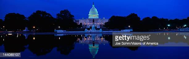 This is the US Capitol set in front of the Capitol reflecting pool at sunset The image of the US Capitol is reflected in the reflecting pool