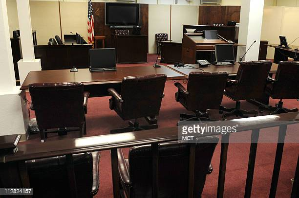 This is the view of Omar Khadr's war court seat at left at the defense table from the front row of the spectator's gallery usually reserved for...