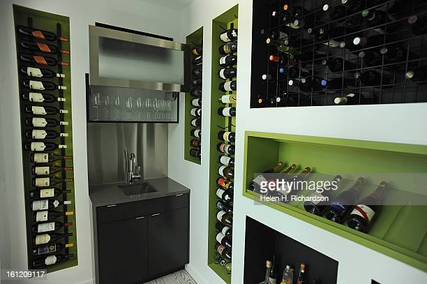 This is the wine cellar This is the home of Cathleen Van Buskirk and her snazzy home at the Erie Air Park Her sleek modern house is right by the...