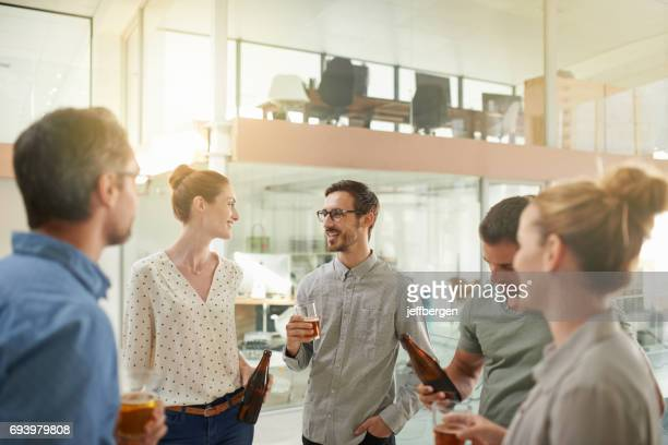 this is what friday's at their company looks like - social gathering stock pictures, royalty-free photos & images