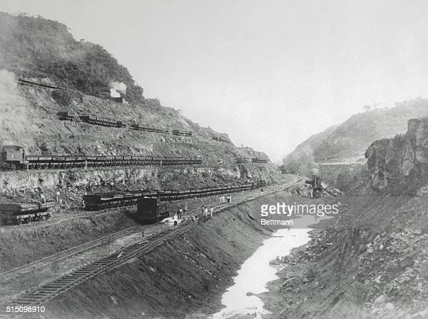This is what Panama's big ditch looked like in December as steam shovels loaded French dump cars near Gold Hill during the excavation of Culebra Cut...