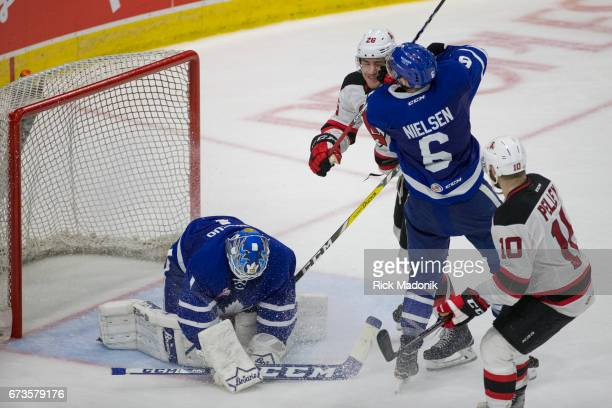 This is what started the mess between Toronto Marlies defenseman Andrew Nielsen and Albany Devils left wing Ben Thomson as Toronto Marlies goalie...