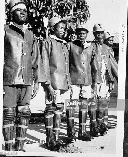 This isn't a line up of Rookie baseball catchers in spite of the caps and shinguards the men are dressed for underground work in Northern Rhodesia's...