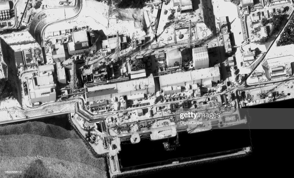 This January 15, 2013, satellite image shows a section of the Fukushima power plant and focuses on the four reactors that sustained the most damage in the tsunami and earthquake. In addition to the four reactors, four turbine buildings, three towers, construction cranes, and several administration and support buildings are visible. Reconstruction progress is visible on Reactor 1; the roof and wall panels covering the contaminated building are complete. Ongoing recovery work is underway at Reactor 4 to construct a new structure for removing spent fuel from the reactor pool.