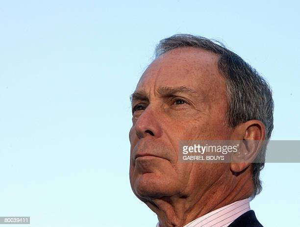 This January 19, 2008 file photo shows New York City Mayor Michael Bloomberg listening as California Governor Arnold Schwarzenegger speaks during a...