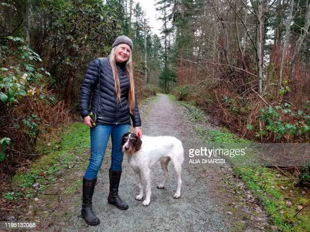 This January 20 2020 photo shows Sue Starkey as she walks her dog near Meghan and Prince Harry's temporary estate in North Saanich Municipality in...