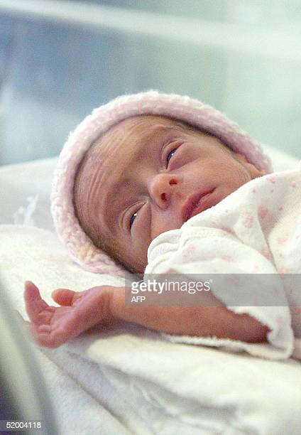 This jhandout picture shows Eliza Maria daughter of 66yearold Romanian Adriana Iliescu in an intensive care unit at the Giulesti Maternity Hospital...
