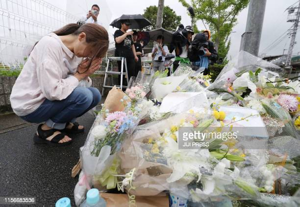 This July 19 2019 picture shows a resident praying for victims of a fire which hit the Kyoto Animation studio building the day before killing 33...