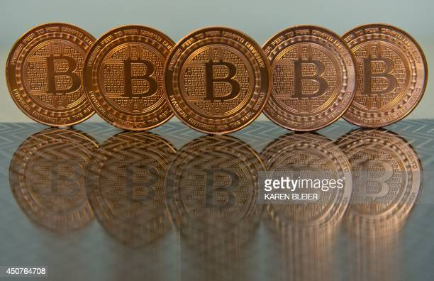 This June 17 2014 photo taken in Washington DC shows bitcoin medals Bitcoin uses peertopeer technology to operate with no central authority or banks...