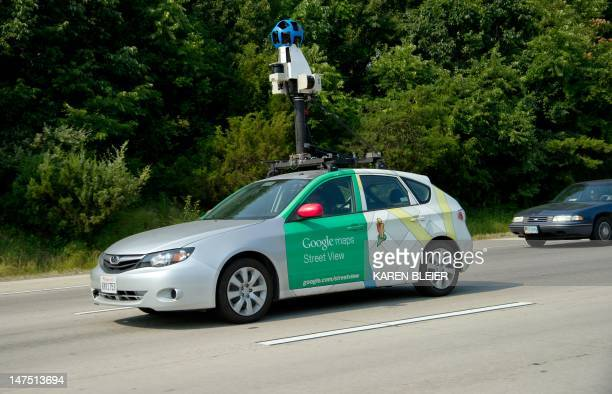 This June 28 2012 photo shows a Google Street View vehicle as it collects imagery while driving down Interstate I66 near Centreville Virginia This...