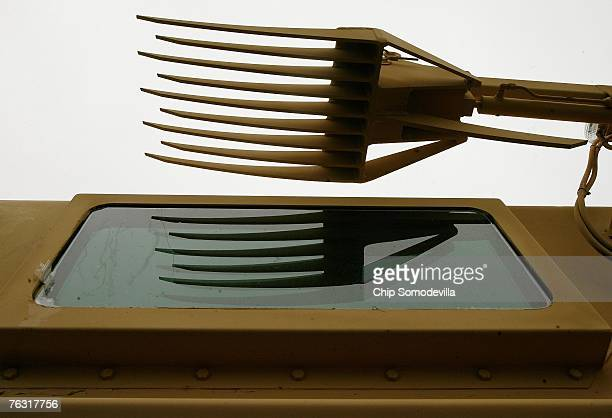 This large fork is at the end of the robotic arm of a Category III Mine Resistant Ambush Protected vehicle or Buffalo on display during a...