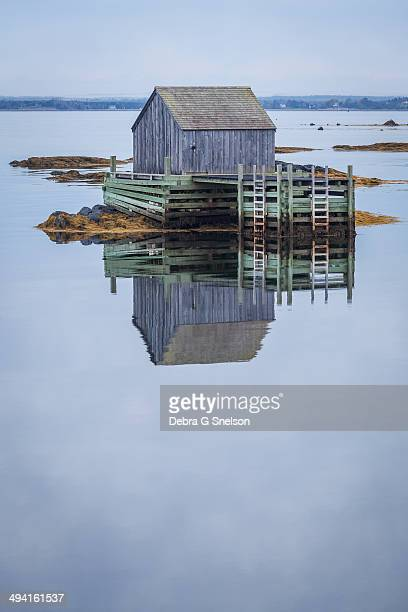 CONTENT] This little fishing shanty was perfectly reflected in the cool calm waters of early morning light