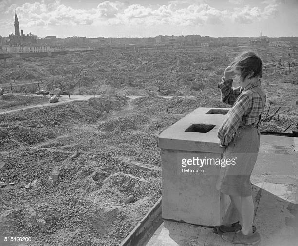 This little Polish girl surveys a scene she will never want to remember the ruins of Warsaw's ghetto where Jews were ruthlessly murdered by the...