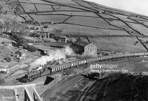 This locomotive 'Seahorse' is heading for Standedge Tunnel with a Hull to Liverpool express train Photograph by Bishop Eric Treacy Treacy was often...