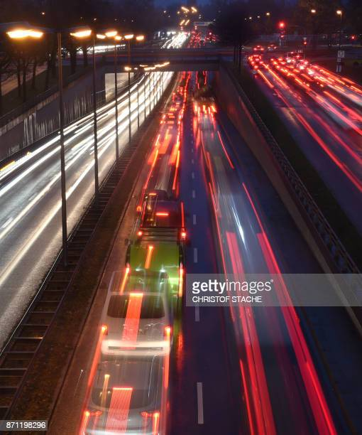 This long exposure photo shows early morning traffic making its way on the motorway in Munich southern Germany of November 7 2017