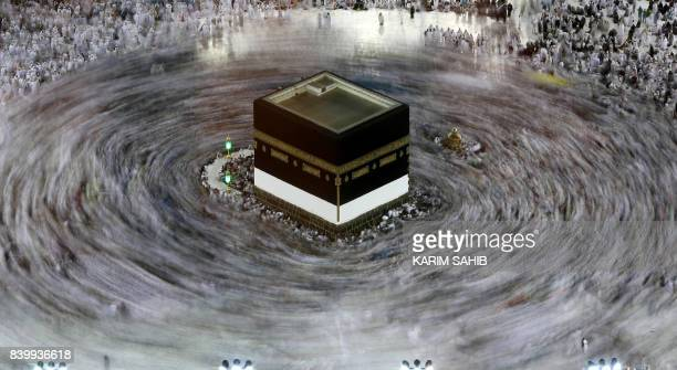 TOPSHOT This long exposure photograph shows Muslim pilgrims circumambulating the Kaaba Islam's holiest shrine at the Grand Mosque in Saudi Arabia's...