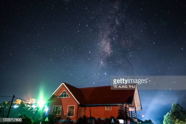 This long exposure picture shows the Milky Way, as seen above a building in Kalaw, Shan state early on July 1, 2020.