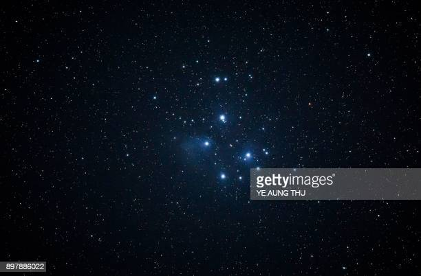 TOPSHOT This long exposure picture taken on December 23 2017 shows the pleiades as seen from Bago located 91 kilometres northeast of Yangon / AFP...
