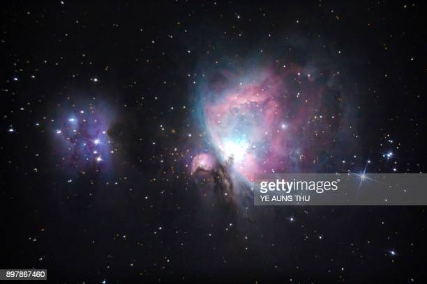 This long exposure picture taken on December 23, 2017 shows the Orion Nebula, as seen from Bago, located 91 kilometres northeast of Yangon. / AFP...
