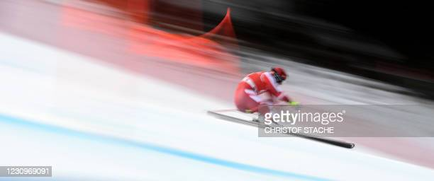 This long time exposure picture shows Austria's Stefan Babinsky as he races during a training session of the men's downhill event at the FIS Alpine...