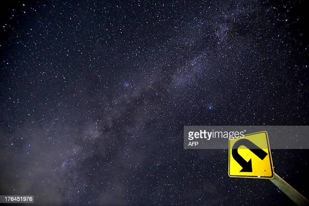 This longexposure photograph taken on August 12 2013 shows the Milky Way in the clear night sky near Yangon The Perseid meteor shower occurs every...
