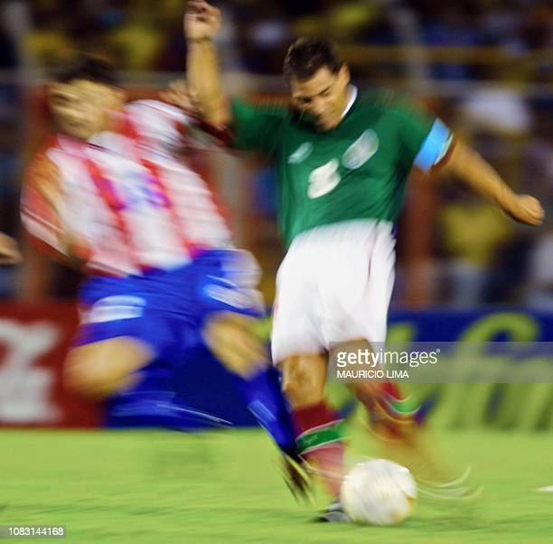 This lowspeed photo shows Mexican soccer team captain Alberto Garcia Aspe as he fights for the ball against Julio Enciso of Paraguay 15 July 2001 at...